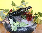 pouring wine bottle fountain | flowing wine bottle fountain | misting wine fountain
