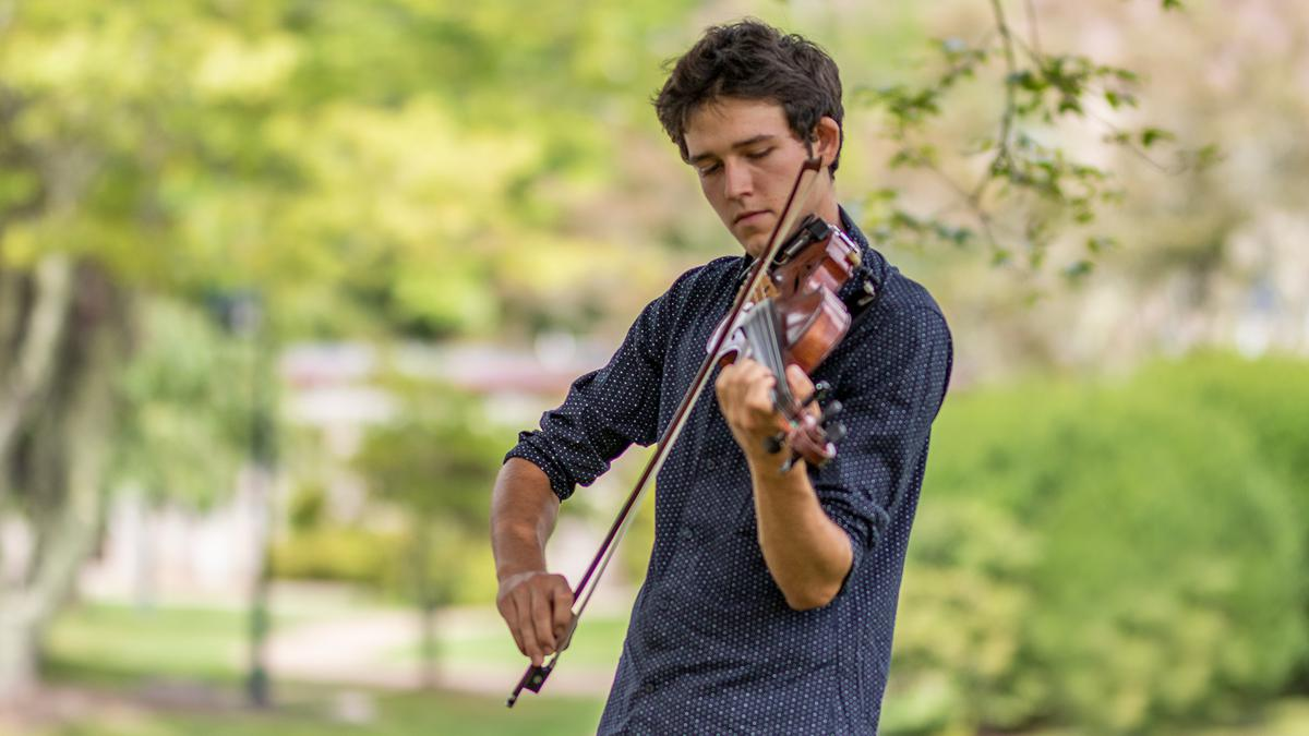 Pedaling and Fiddling: Grayson Wickel exploring his passions on the bike and on the stage