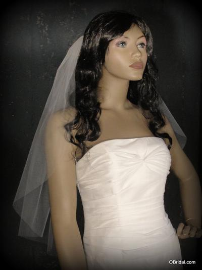 A Plain Cut Edging On Wedding Veil Will Blend In With Gown Almost Disearing So The Take Front Stage