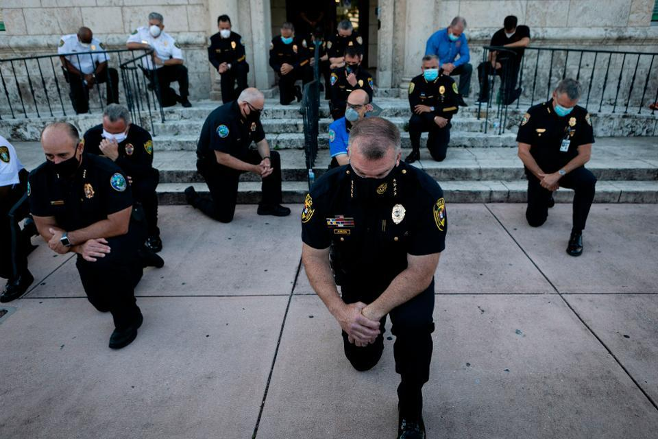In Some Cities, Police Officers Joined Protesters Marching Against Brutality