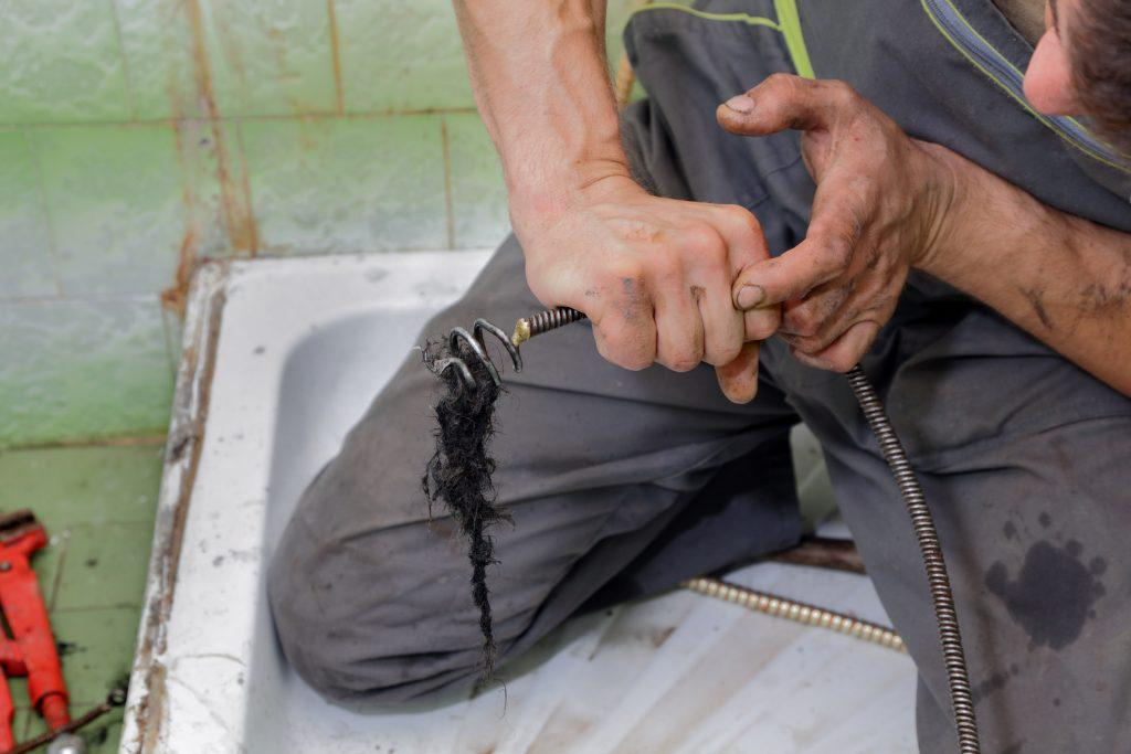 How to Use a Plumbing Snake (and When Not to)