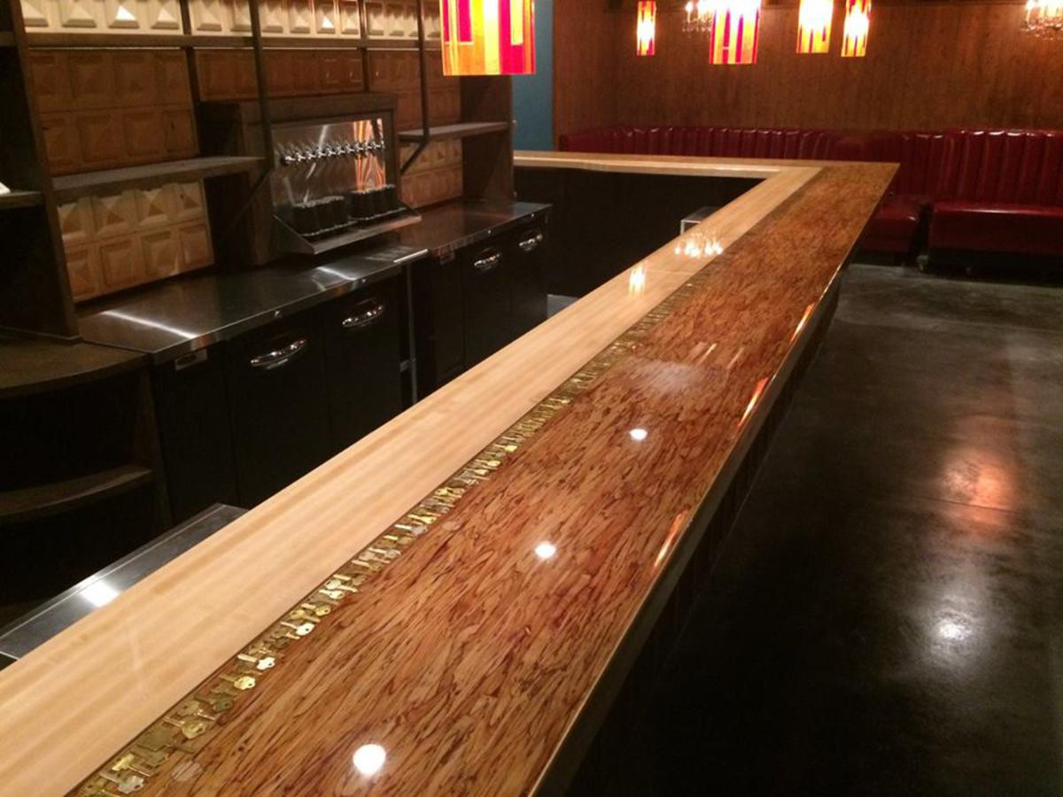Custom P-LAM epoxy bar top made for a retro themed bar & lounge in Portland, Oregon.