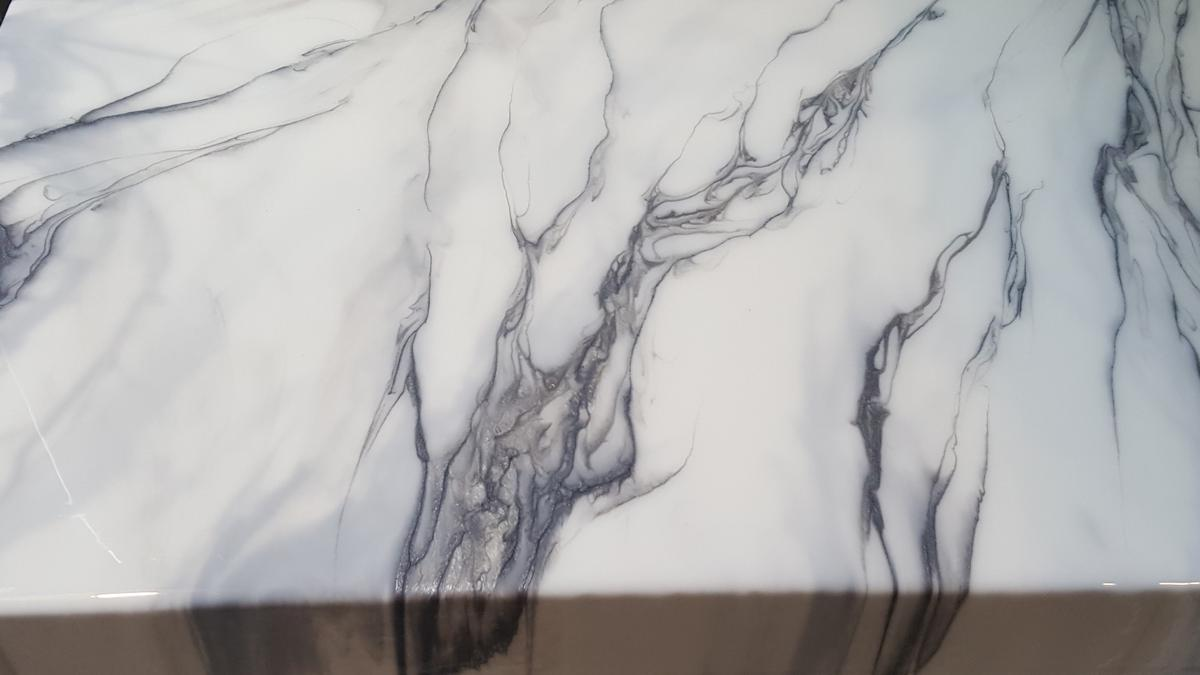 Hand-poured faux carrara style white marble epoxy countertop over a client's DIY concrete countertop in Beaverton Oregon. Titanium and gunmetal veining/accents.
